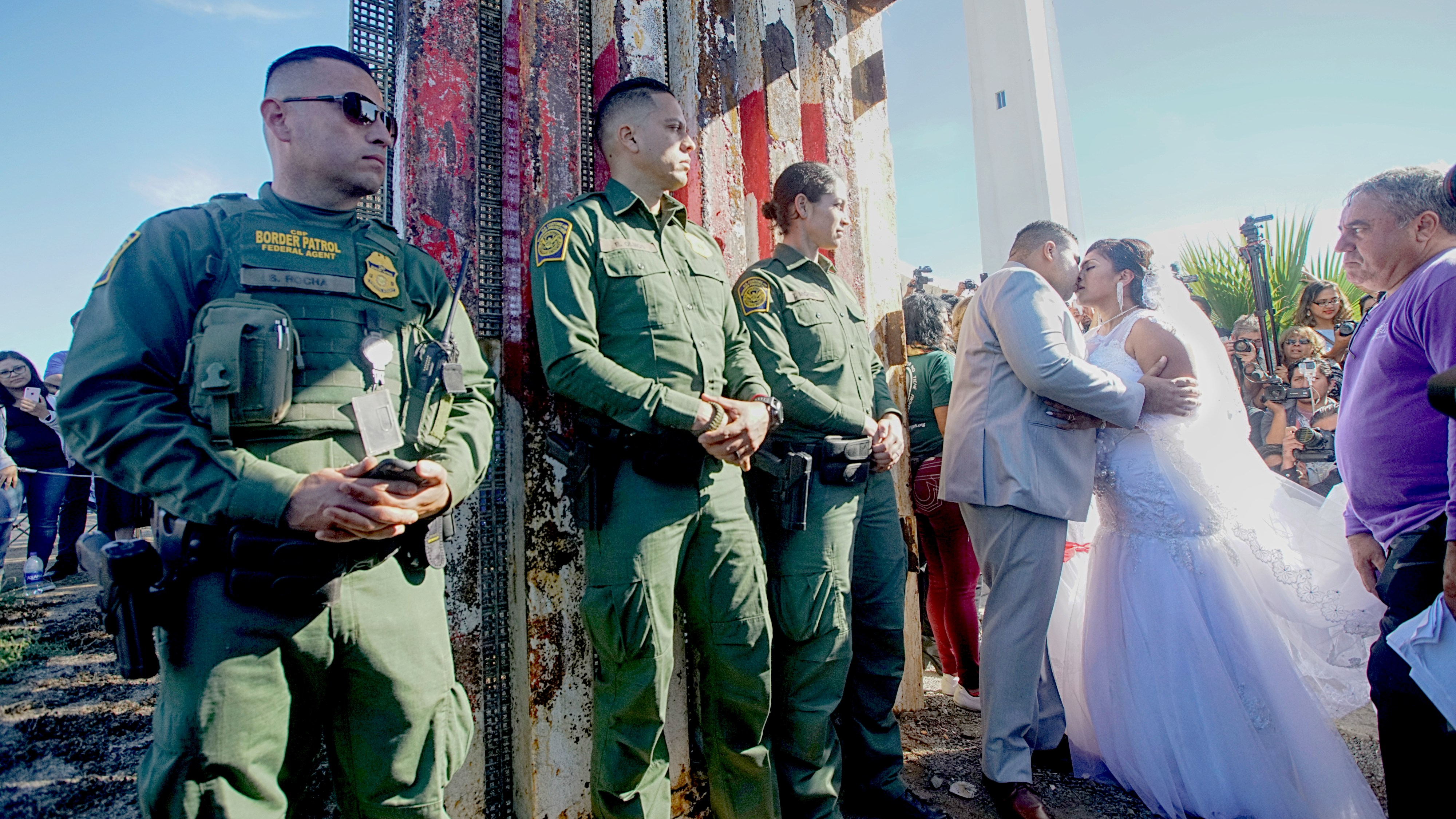 Cartel wedding secured by armed border patrol agents for Door of hope san diego